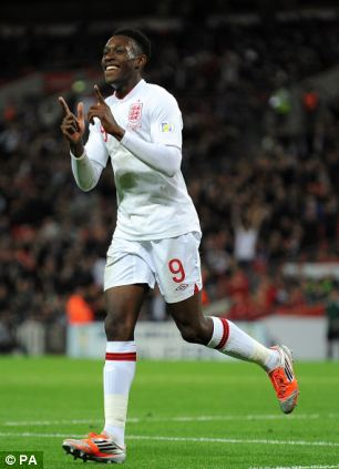 England's Danny Welbeck celebrates after scoring his team's second goal during the 2014 FIFA World Cup Qualifying match at Wembley, London.