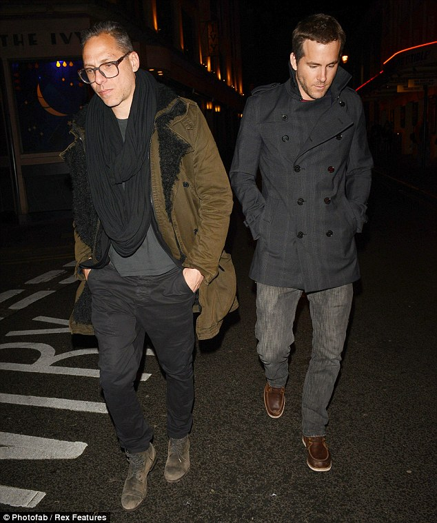 Head down: Ryan put his hands in his pockets after dining at The Ivy restaurant in central London