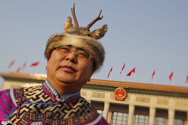 Headwear: A delegate from the Oroqen ethnic minority wears a deer hat before the opening session of the Chinese National Peoples Congress