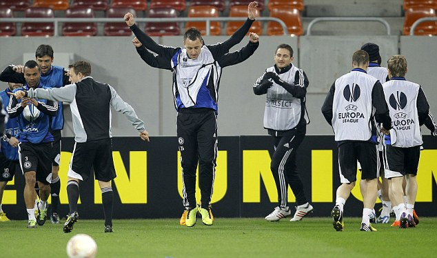 Flying high: John Terry leads the Chelsea players as they prepare for tomorrow's crunch clash