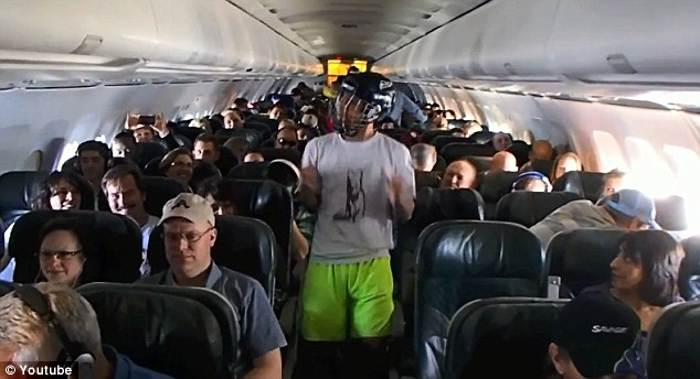 In this Harlem Shake, called 'Shakes on a Plane' a lone man dances in the aisle of an aeroplane...