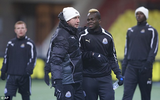 Ice reception! Alan Pardew jokes with Cheick Tiote (right) ahead of the crunch clash