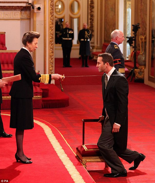What a Knight: Sir Ben Ainslie (right) receives his Knighthood from the Princess Royal