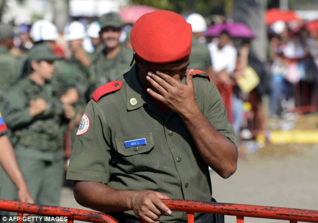 An honor guard cries during the funeral cortege