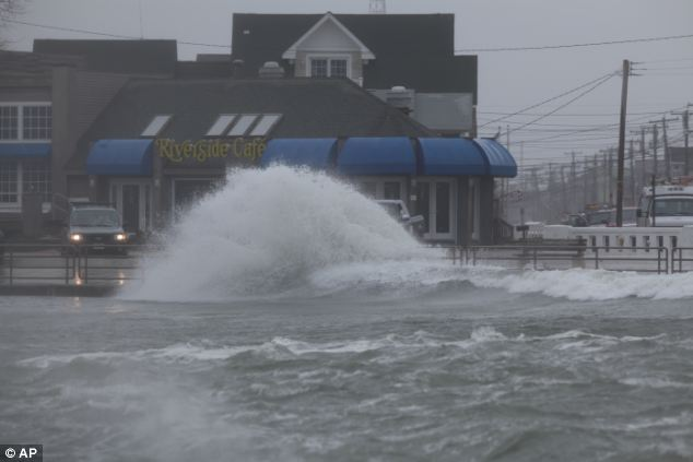 More trouble: Wind, rain and the tide batter the Jersey Shore as a winter storm moves at the Point Pleasant inlet in Manasquan, New Jersey, which was hit by Superstorm Sandy last year