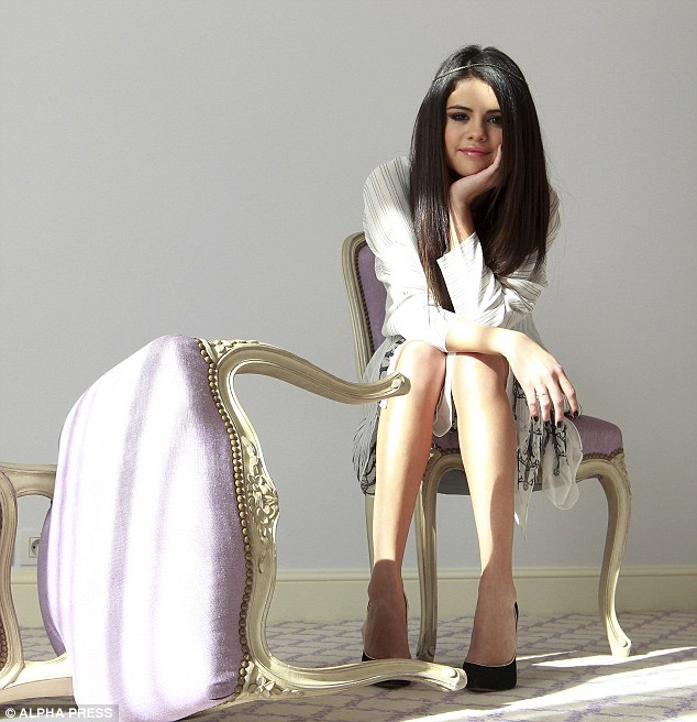 Picture perfect: The actress looked pretty as she sat politely in the simple and quaint setting