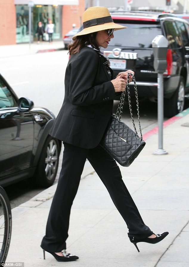 Dynasty: The 79-year old wore a black suit, monochrome blouse, matching shoes and a Chanel handbag