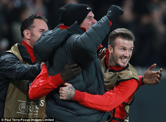 The beautiful game: David celebrates a victory during the game which is likely to have pleased his family who were watching on from the stands