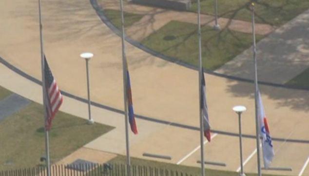 The Citgo flags at half mast to honor President Hugo Chavez in Houston, Texas