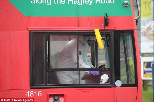 Scouring the scene: A forensics officer gathers clues on board the 9 National Express West Midlands bus