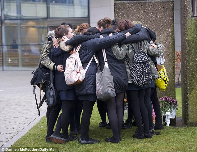 Friendship ring: Teenagers from Christina's school huddle together as they come to terms with her death