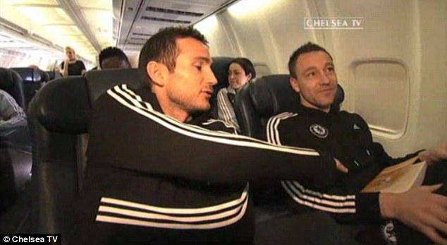Food for thought? Frank Lampard jokes and points to Terry's book, which says short-term managers have no impact, and below, the video interview in full