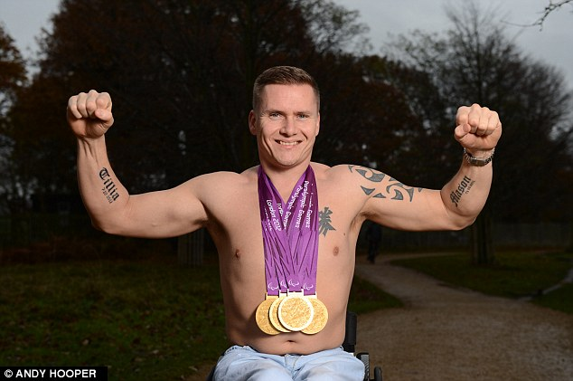 Solid gold: Weir shows off his four winners' medals
