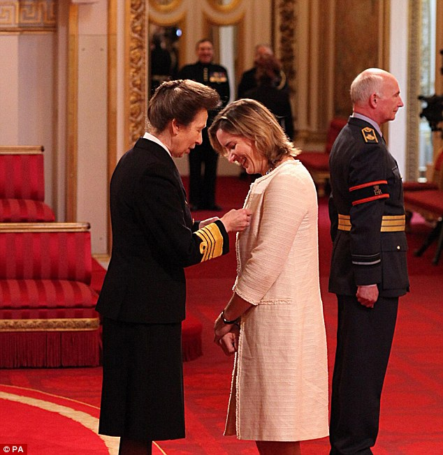 Great honour: Rower Katherine Grainger receives her CBE from the Princess Royal