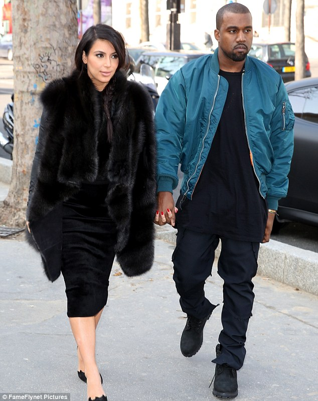 Pregnancy scare: Kim Kardashian is said to have been rushed to the doctors on Tuesday night after returning to Los Angeles from Paris, where she had been enjoying Fashion Week with boyfriend Kanye West