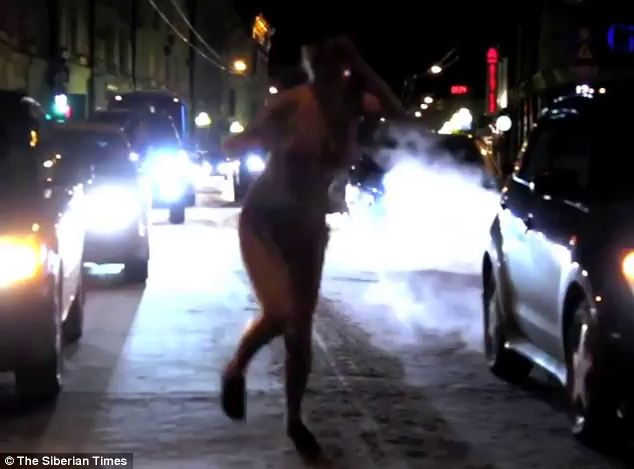 She surely felt the cold as she jogged along a frost-covered motorway