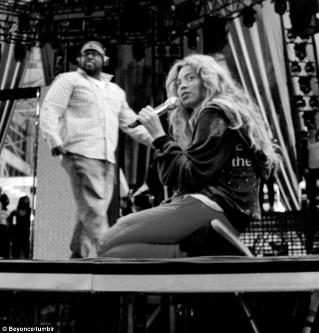 Hard at work: Beyonce also posted this photo in which she is seen presumably at rehearsals for her upcoming world tour The Mrs Carter Show