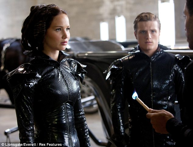 Love rivals: Peeta and Gale will be competing for Katniss' affections when the film hits cinemas on November 22