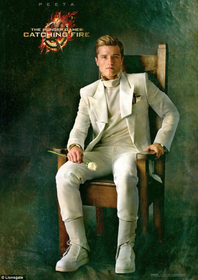 Ready for battle: Josh Hutcherson is also making a return as Peeta, and can be seen in all-white in his portrait