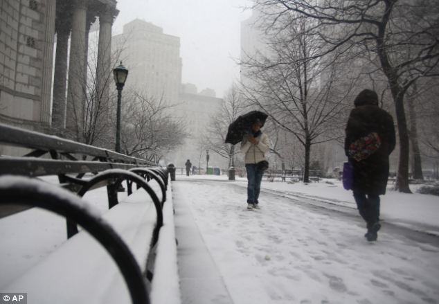 Winter storm: People walk through driving snow near courthouses in lower Manhattan on Friday