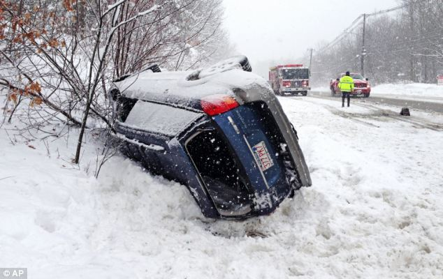 Danger: A Subaru Outback rolled over on Rt 20 in Charlton, Massachusetts blocking part of the road