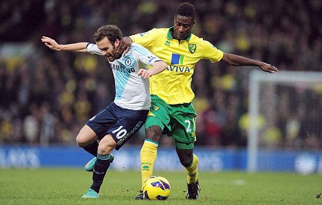 Sidelined: Alex Tettey (right) hasn't featured for Norwich in a month
