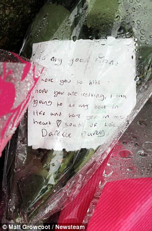 Tributes: A shrine grew near to where Miss Edkins died today as people laid floral tributes at the scene.