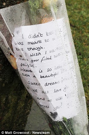 'Sweet dreams': A bouquet with a message of tribute lies at the scene
