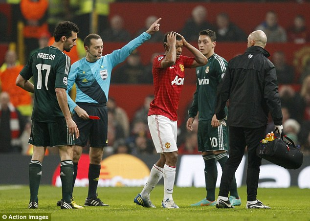 Controversy: Cakir gives Nani his marching orders on Tuesday night