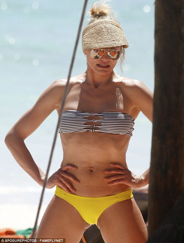 Rock hard: Cameron Diaz shows off her flat stomach and toned frame as she poses up on the beach