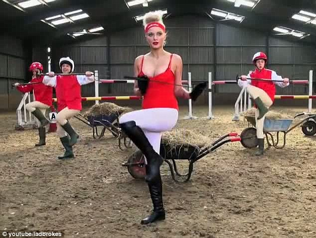 She's got the moves: Helen holds a saucy riding crop as she does some of the 'work-out' moves with for the Ladbrokes video