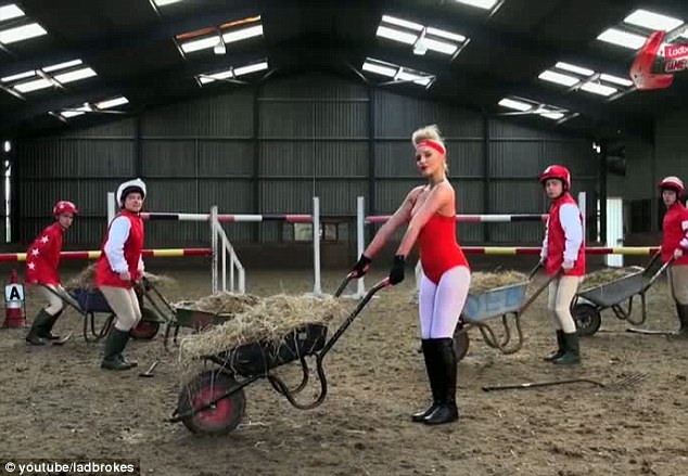 Mucking out: At one point the star pushes a wheelbarrow of hay around, flexing her muscles