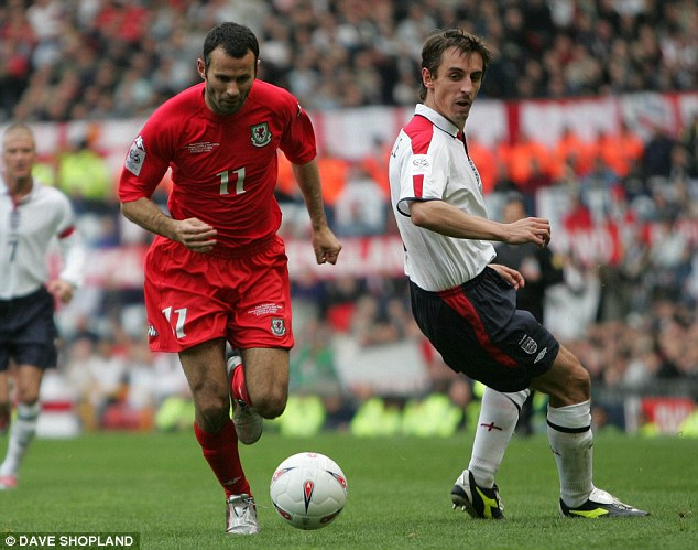 Like a kipper: Giggs skips past Neville in a World Cup qualifier between England and Wales in 2004