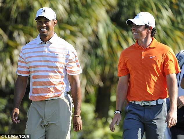 Good to tak: Tiger Woods and Rory McIlroy during the second round