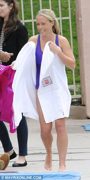 Pretty in purple: Kendra practiced her moves in an amethyst-hued suit too