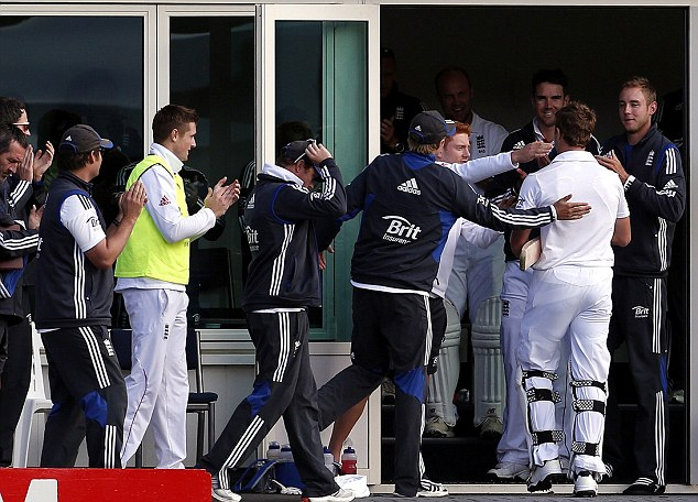 Well done: Compton is congratulated by teammates as he walks into the dressing room after the fourth day