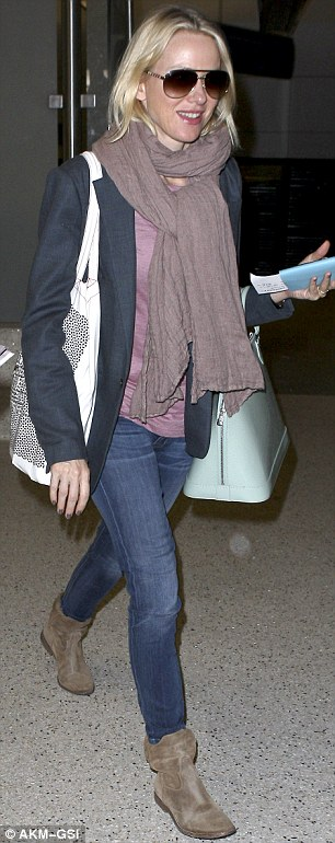 Casual arrival: Naomi arrived back in Los Angeles on Friday