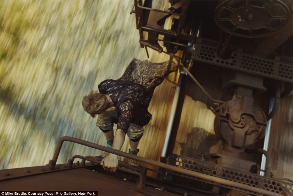 Riding the railroads isn't without its risks, as this striking image of a train-hopper leaping daringly between carriages shows. The photograph is one of many taken by a 35mm Nikon F3