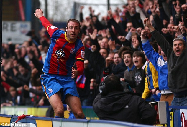 Goal Machine: Glenn Murray celebrates after his brace took him to 30 goals for the season