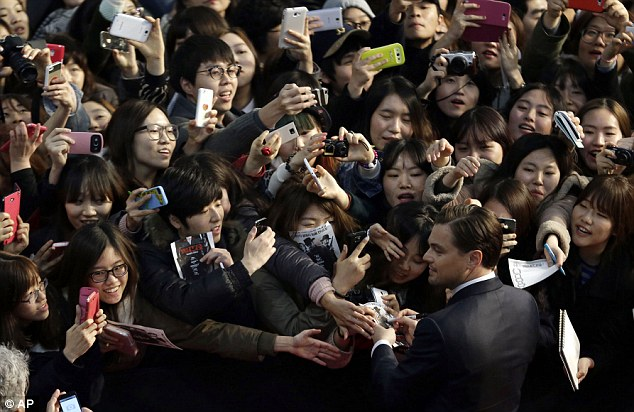 Surrounded: Hundreds came out to catch a glimpse of the star