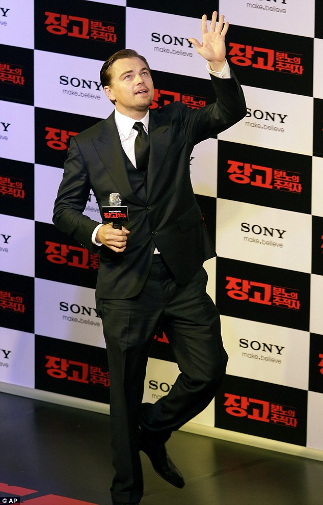 Having a ball: The star smiled and appeared to enjoy the attention from his adoring devotees as he walked the red carpet at the premiere