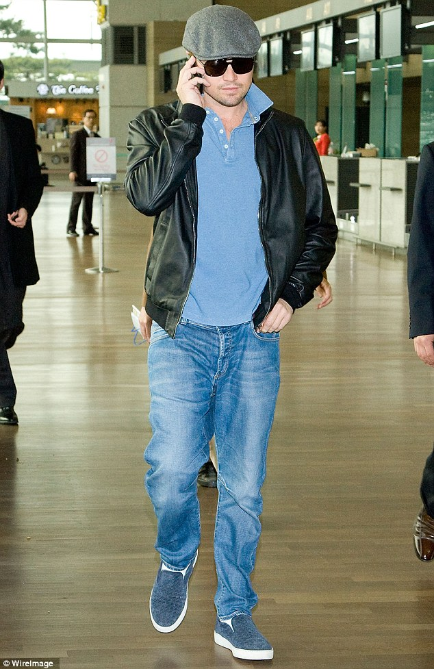 Dapper: Leonardo DiCaprio was dapper in a newsboy cap as he made his way through Incheon International Airport in South Korea on Friday