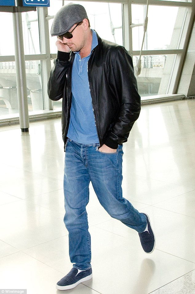 Stylish: The Titanic heartthrob looked handsome and stylish in a pale blue polo top worn underneath a leather jacket, a pair of light blue jeans and suede slip-on shoes
