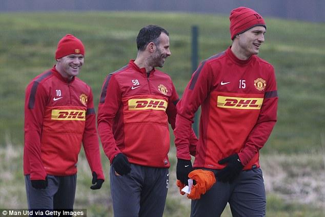 Enjoying the present: Wayne Rooney, Giggs and Nemanja Vidic share a moment in training