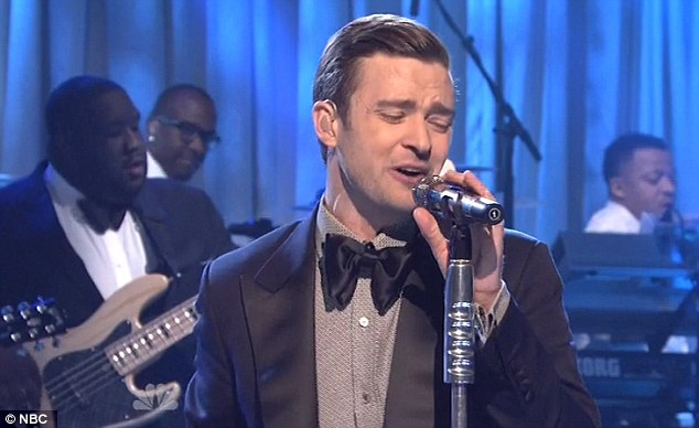 Returning the favour: Justin Timberlake took a swipe at Kanye West when he performed his hit song Suit & Tie on Saturday Night Live on Saturday