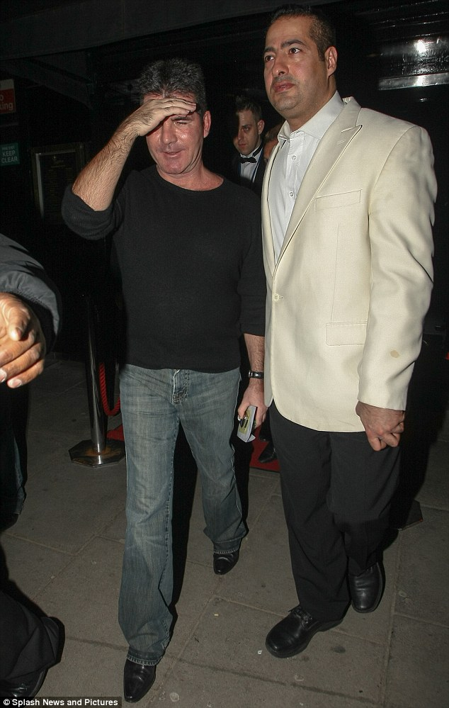 VIP coming through: Simon Cowell leaves Stringfellows nightclub in London after enjoying a night out in the city