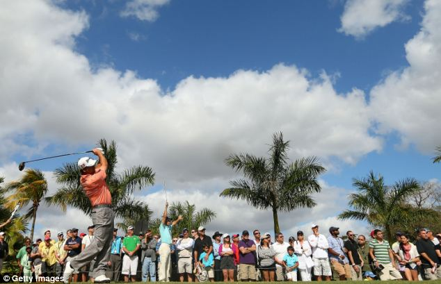 Playing partners: Graeme McDowell also played well to finish second on the leaderboard