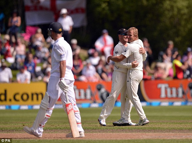 Another breakthrough: Wagner celebrates with captain Brendon McCullum after taking the wicket of England's Trott