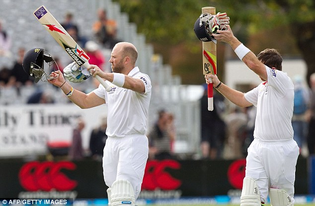 Seeing England home: Matt Prior and Ian Bell wave to the fans as they walk from the field at the end of the game