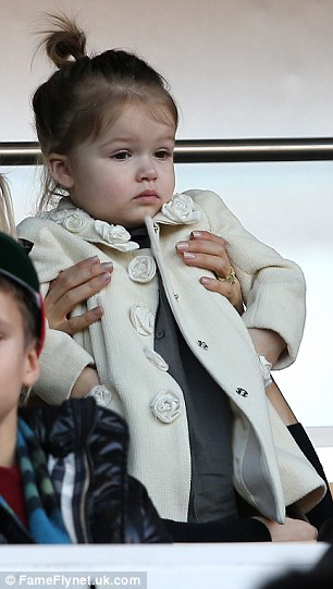 Enthralled: While there was a lot going on around her, Harper appeared intent on watching the goings on on the pitch